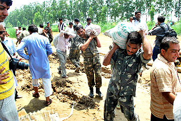 Army personnel help in rescue efforts