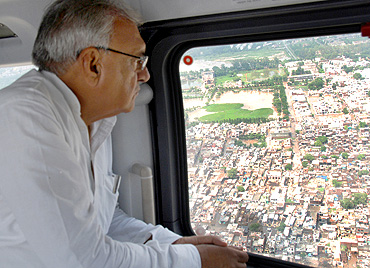 Haryana Chief Minister Bhupinder Singh Hooda surveys the flood-hit areas