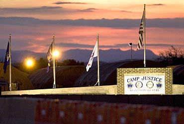 The sun sets over Camp Justice and its adjacent tent city