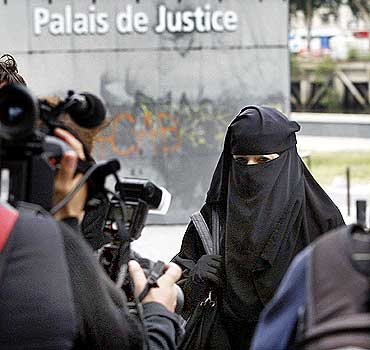 A French woman who was fined for wearing a niqab while driving speaks to the media