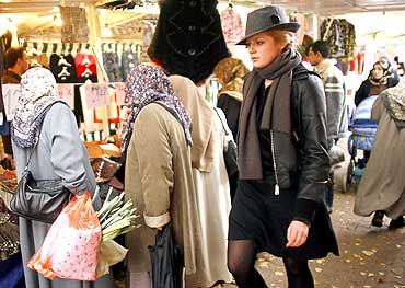 Veiled women shop at a market in Berlin