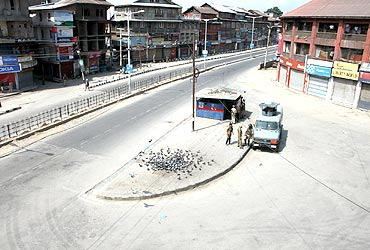 Srinagar bore a deserted look as curfew was clamped in some areas on Tuesday