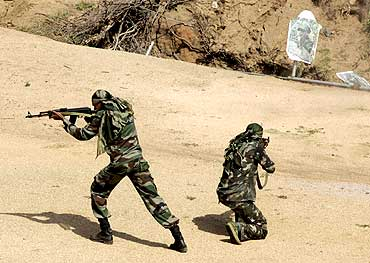 Security personnel train at a jungle warfare school in Kanker, Chhattisgarh