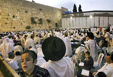 Jewish worshippers pray at the Western Wall in Jerusalem