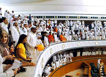 Kuwaitis attend a Parliament session on electoral law
