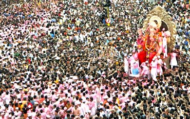 Devotees carry a statue of Lord Ganesh during immersion in Mumbai