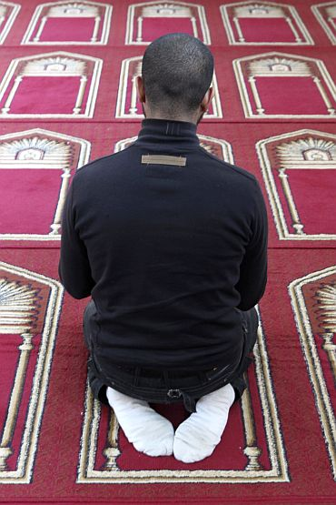 A Muslim man prays in the Er-Rahma mosque in Nantes, western France