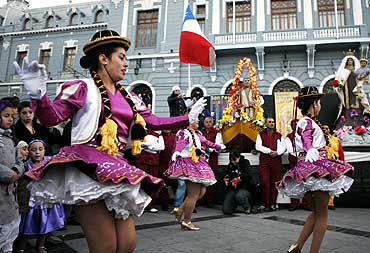 Chileans in traditional costumes dance during the annual pilgrimage of San Pedro