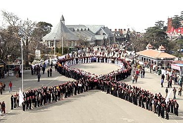 Students form the symbol of AIDS to mark World AIDS Day