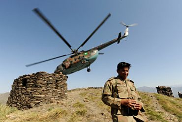 File photo shows an army officer outlines Pakistani positions along the border with India