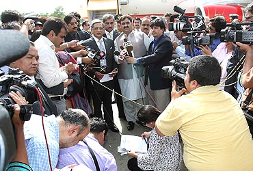 Krishna addresses the media at the Chaklala airport in Islamabad