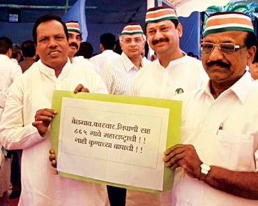 MNS legislators show a placard seeking the inclusion of 865 Marathi speaking villages