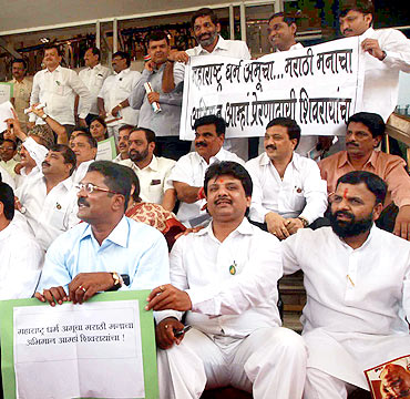 Maharashtra Opposition legislators protest outside the Maharashtra assembly