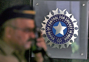 A policeman walks past the Board of Control for Cricket in India headquarters in Mumbai