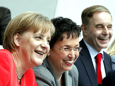 Chancellor Angela Merkel, left, with Free Democratic Party leaders Birgit Homburger, Joerg van Essen