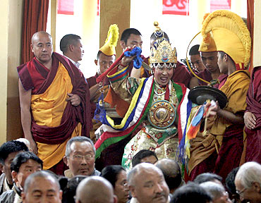 A member of the Nechung Oracle arrives for prayers for the Dalai Lama in Dharamsala last year