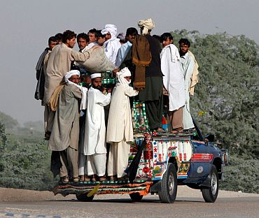 File photo shows residents fleeing a military offensive against the Pakistani Taliban enter Dera Ismail Khan from South Waziristan on October 19, 2009