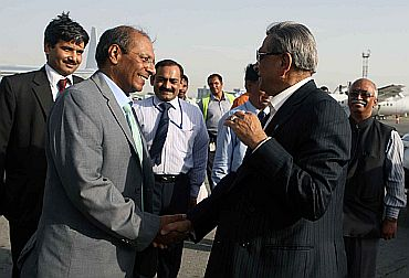 Krishna bids good bye to Indian Ambassador in Afghanistan Gautam Mukhopadhyay in Kabul airport on Tuesday