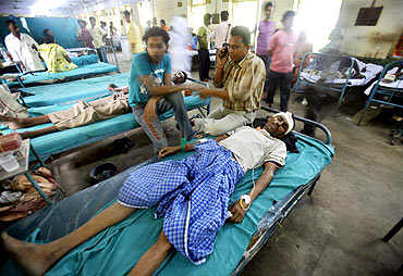 A victim of the train accident rests inside a hospital at Suri