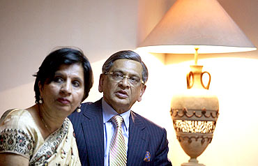 Foreign Minister SM Krishna and Foreign Secretary Nirupama Rao wait outside Pakistan Prime Minister Yusuf Raza Gilani's office in Islamabad on July 15, 2010