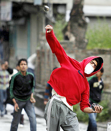 A stone-thrower in action in Kashmir valley