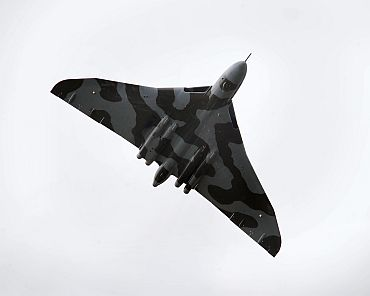 A Royal Air Force Vulcan shows its skills on the third day of the Farnborough International Airshow