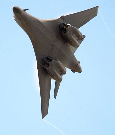 A Boeing B1-B bomber makes a manoeuvre on the second day of the airshow