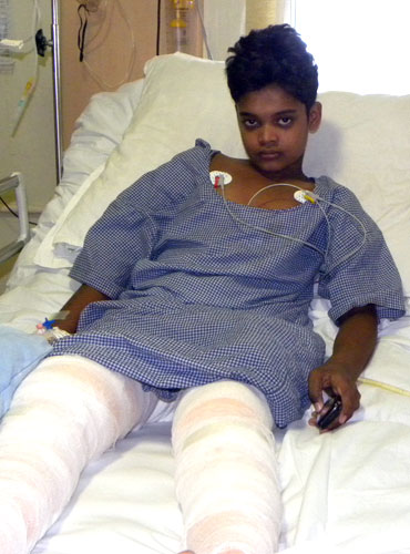 Abhijit Gautam, 12, recovering from gun-shot wounds in a Raipur hospital.