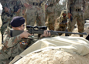 Pakistan army chief General Ashfaq Parvez Kayani firing a sniper rifle