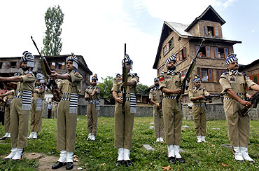 Policemen at a Srinagar graveyard on martyrs' day, July 13