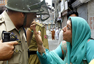 A Kashmiri woman confronts the police during protests in Srinagar, July 6