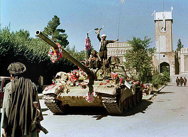 A file photograph shows Taliban members celebrating the seizure of Kabul