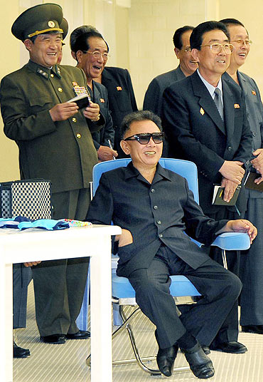 North Korean leader Kim Jong-il smiles during a visit to a swimming pool