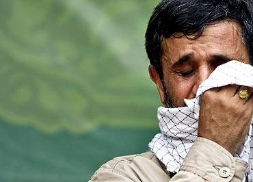 Iran's President Mahmoud Ahmadinejad cries during a religious ceremony