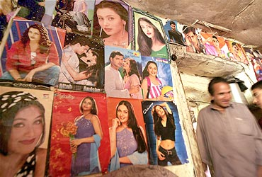 Posters of stars decorate an Afghan house in Kabul