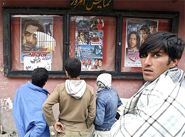 Afghan boys look at Bollywood movie posters