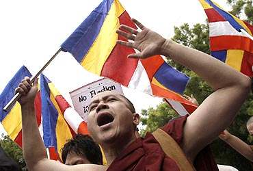 A monk shouts during a protest against Than Shwe in Delhi