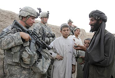 US soldiers chat with residents as they patrol in the village of Gorgan, Afghanistan