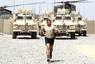 A US soldier runs in the millitary base of Gorgan, Afghanistan