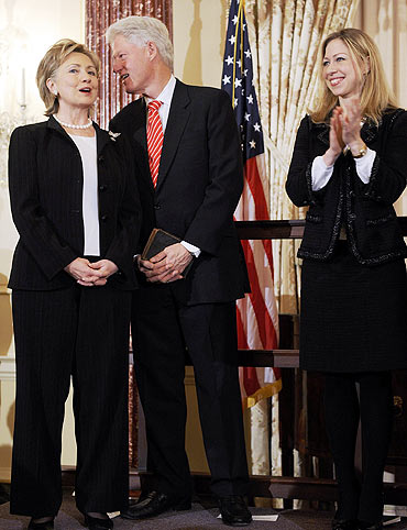 US Secretary of State Hillary Clinton with her husband Bill and daughter Chelsea
