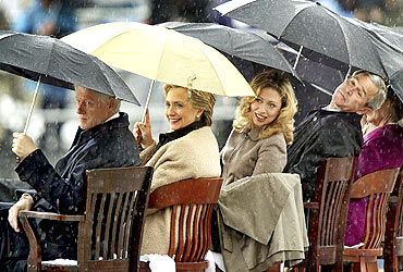 Former US President George W Bush with the Clinton family