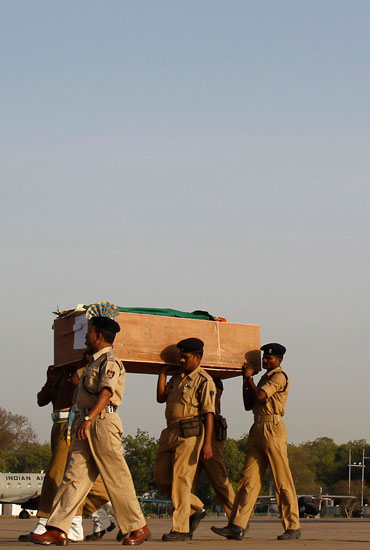 CRPF men bear a coffin of a trooper slain in the Dantewada massacre