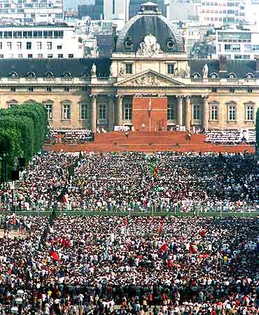 A crowd of pilgrims attend a mass on the Champs de Mars in Paris
