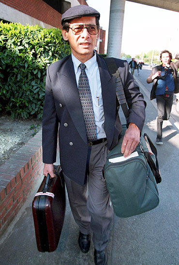 Sobhraj leaves the lawcourt of Bobigny in the Paris suburb in 1997