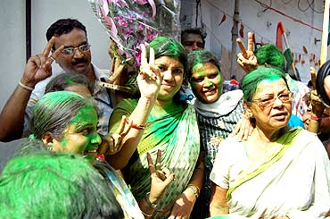Trinamool supporters celebrate the win in civic polls