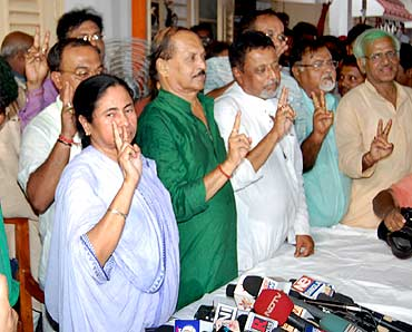 Trinamool Congress chief Mamata Banerjee and party leaders celebrate their victory