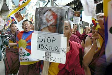 Tibetan monks protest the Chinese crackdown in Lhasa
