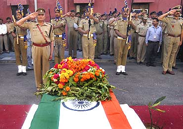 CRPF personnel pay homage to a colleague killed in a Maoist attack in Chhattisgarh on April 6, 2010.