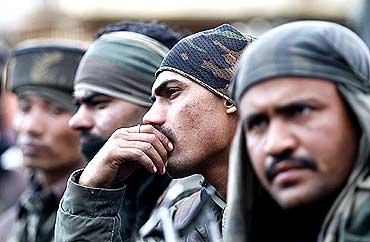 Indian soldiers rest during a gun battle with militants in Dadsar village near Srinagar.