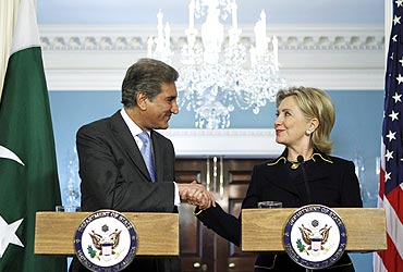 US Secretary of State Hillary Clinton shakes hands with Pakistani Foreign Minister Shah Mehmood Qureshi at a meeting in Washington